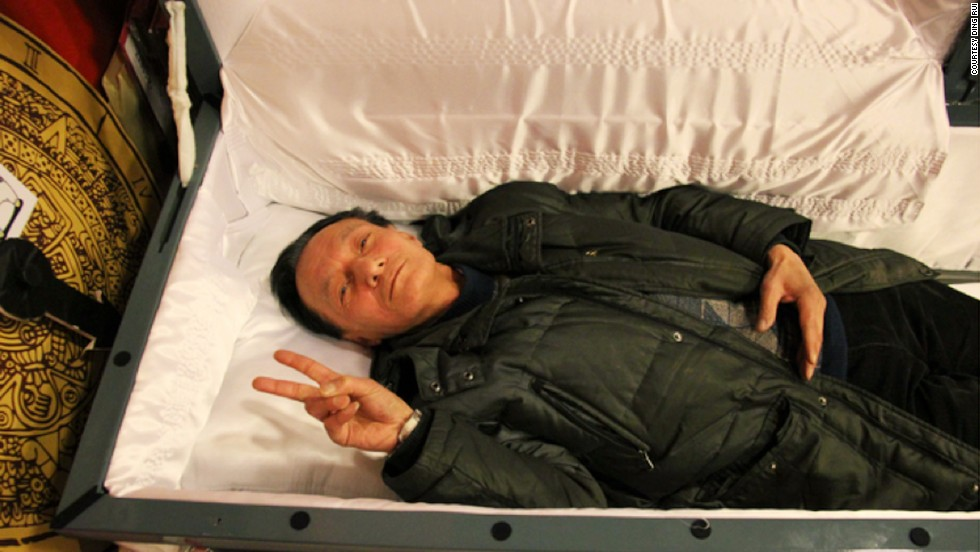 """China made me rich, but it didn't teach me how to live a rich life. I was lost,"" says Huang Wei-pin, creator of a death-themed game in which participants can try out a coffin."