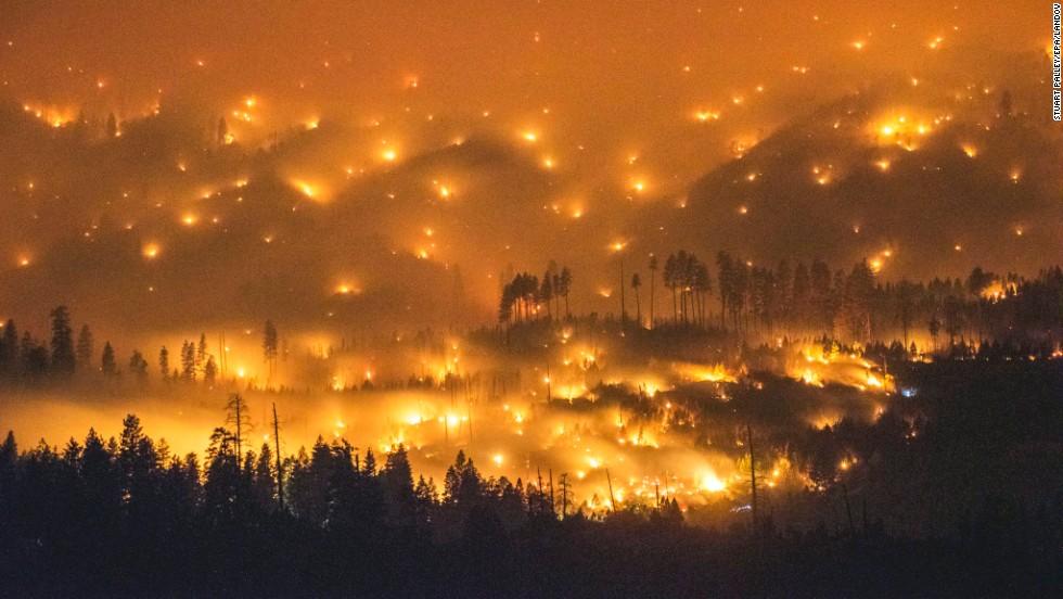 A long exposure image shows the El Portal Fire burning near Yosemite National Park, California, on Sunday, July 27.