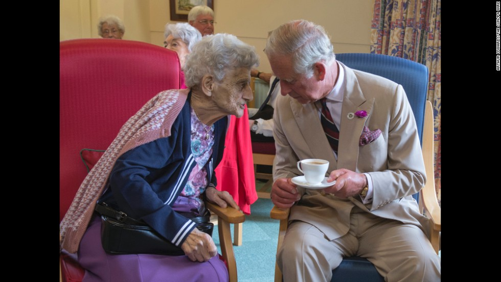 The Prince of Wales meets one of the residents of the St John and St Anne Almshouse in the town of Oakham in England on Monday, July 28.
