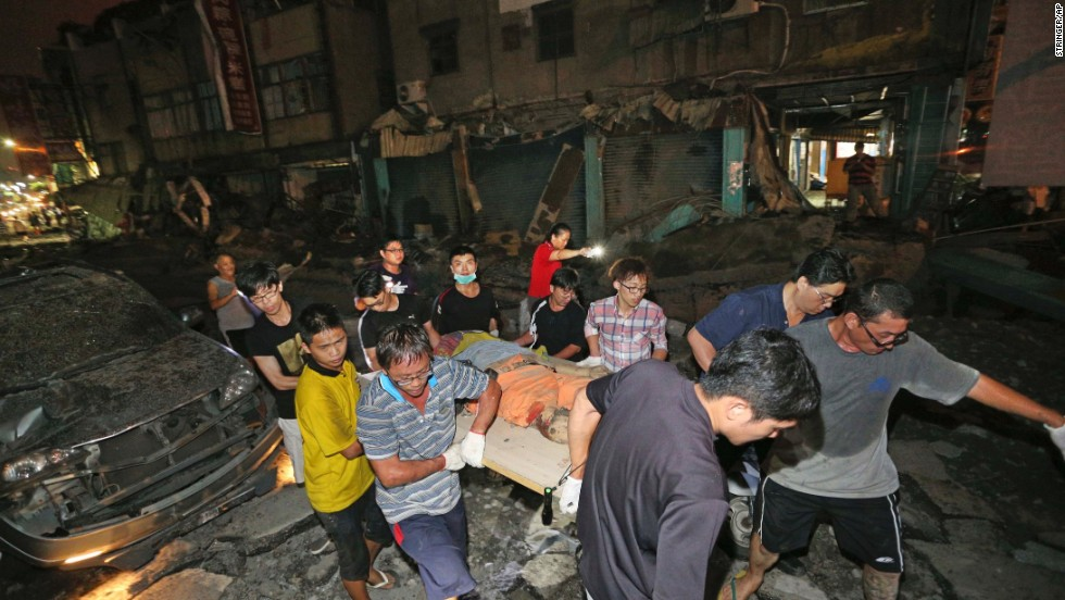 "The body of a victim killed in a <a href=""http://www.cnn.com/2014/07/31/world/asia/taiwan-explosions/index.html"" target=""_blank"">gas explosion from an underground gas leak in Kaohsiung, Taiwan,</a> is carried from the rubble on Friday, August 1. The explosion killed several people and injured hundreds more."