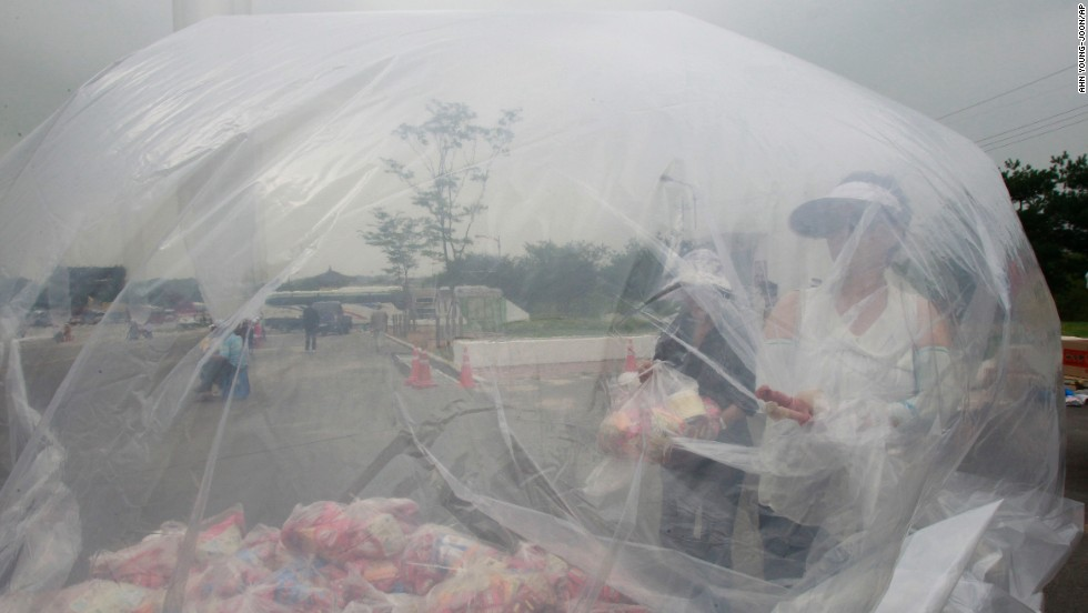 Volunteers comprised of former North Koreans and South Korean activists prepare plastic bags of the snacks on Wednesday.