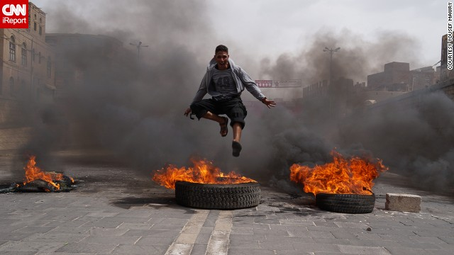 A Yemeni teen takes part in a street riot over fuel prices.