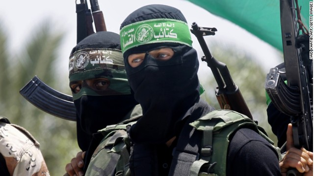 Palestinian militants of the Ezzedine al-Qassam Brigades, Hamas' armed wing, attend the funeral of militant Mohammed Obied during his funeral in the town of Deir al-Balah, in the central Gaza Strip on June 30, 2014.