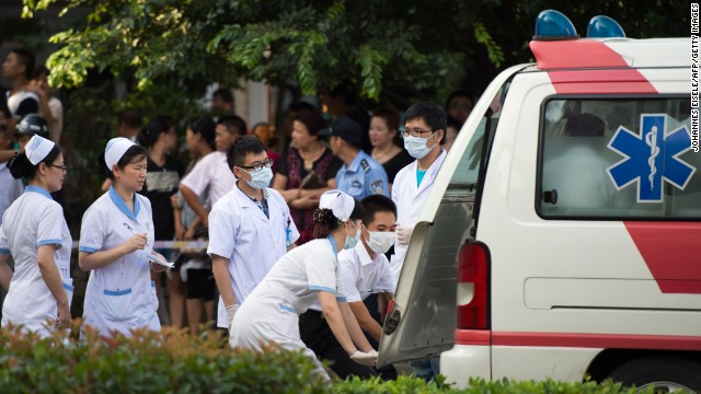 A victim is taken to hospital after a factory explosion in Kunshan on August 2, 2014