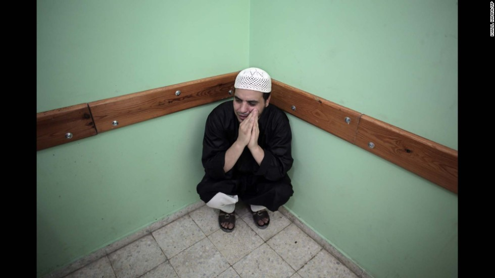 A Palestinian man sits in a hospital in Rafah, Gaza, on August 3.