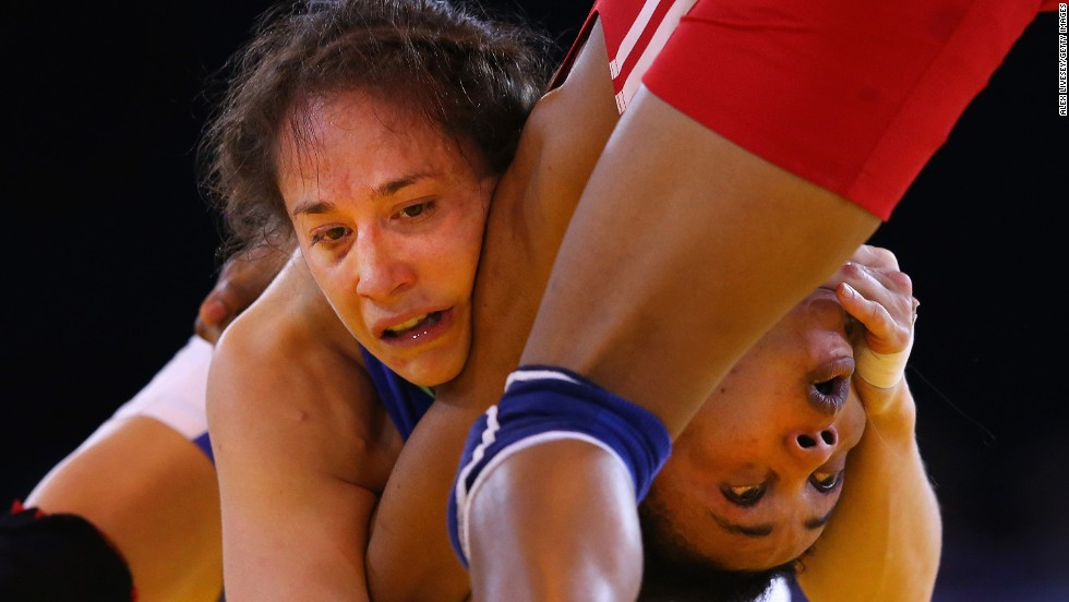 Canada's Brittanee Laverdure, left, and Nigeria's Ifeoma Nwoye wrestle Thursday, July 31, in the semifinals of the 55-kilogram (121-pound) weight class at the Commonwealth Games in Glasgow, Scotland. Laverdure won the match and the final as well to take the gold medal.