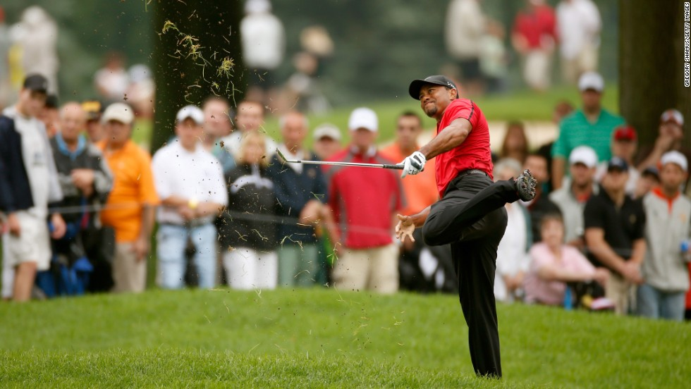 "Tiger Woods hits out of the rough during the final round of the WGC-Bridgestone Invitational, which was played Sunday, August 3, in Akron, Ohio. Woods <a href=""http://www.cnn.com/2014/08/03/sport/golf/golf-woods-new-injury-blow/index.html"">reinjured his lower back</a> during the round, forcing him to pull out of the tournament. Woods had just recently returned to competitive action after taking three months off to have surgery."