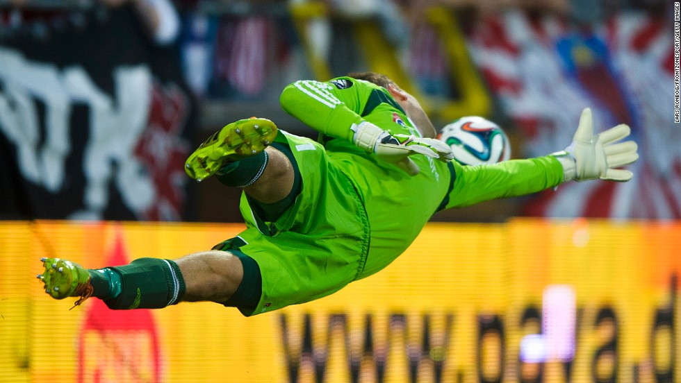 Nicolai Larsen, a goalkeeper for Danish soccer club Aalborg, reaches for a shot Wednesday, July 30, during a UEFA Champions League qualifying match against Croatian club Dinamo Zagreb in Aalborg, Denmark. Dinamo won the match 1-0 off this shot from Marcelo Brozovic.