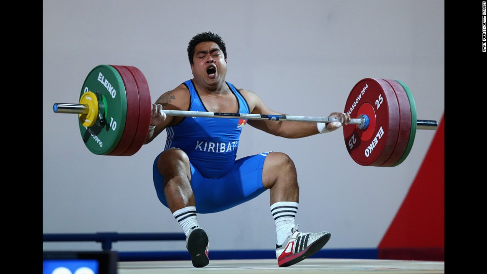 David Katoatau of Kiribati drops the bar during a weightlifting event Wednesday, July 30, at the Commonwealth Games in Glasgow, Scotland. He won gold in his 105-kilogram (231-pound) weight class.