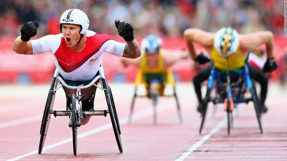 David Weir of England crosses the line to win gold in the T54 1,500-meter final Thursday, July 31, at the Commonwealth Games in Glasgow, Scotland.