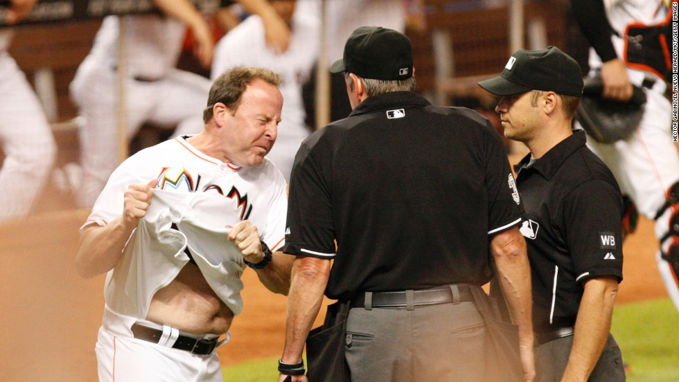 Miami Marlins manager Mike Redmond reacts furiously after a call at home plate Thursday, July 31, during a game against the Cincinnati Reds in Miami. Redmond was ejected from the game for his eighth-inning outburst, and the Reds won 3-1.