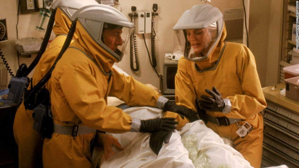 """In 1995's """"Outbreak,"""" Dustin Hoffman and Rene Russo work to contain Motaba, a fictional disease similar to Ebola. The outbreak spreads from Africa to the United States via an infected monkey before a serum is created."""