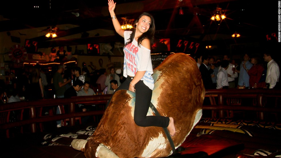 A big ol' wooden lair done up with hay bales and mannequins in racy Western regalia, The Saddle Ranch Chop House is a steak and taters place with a mechanical bull.