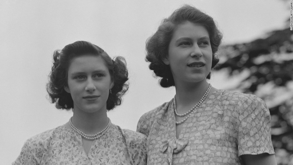 Princess Elizabeth, right, and Princess Margaret wear summer dresses circa 1942.