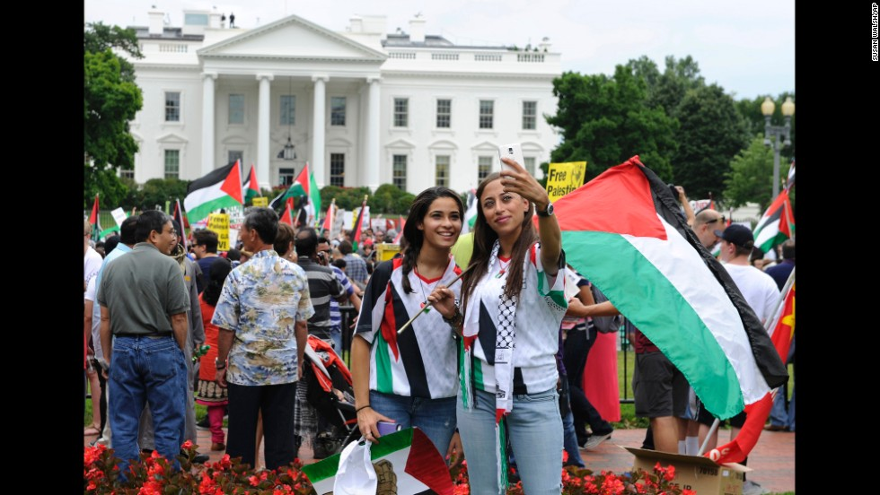 Abby Salem, left, and her cousin Samira Salem pose for a selfie outside the White House during a rally against the violence in Gaza on Saturday, August 2, in Washington.