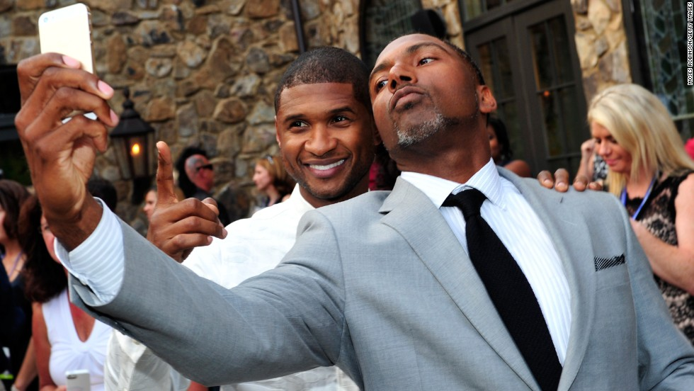 "R&B singer Usher, left, and retired NFL football player Allen Rossum attend the 15th anniversary celebration of Usher's New Look Foundation on Wednesday, July 30, in Atlanta. The charity, according to <a href=""http://ushersnewlook.org"" target=""_blank"">its website</a>, ""is dedicated to engaging disconnected youth to find a path to leadership and help them make career choices that match their passion."""