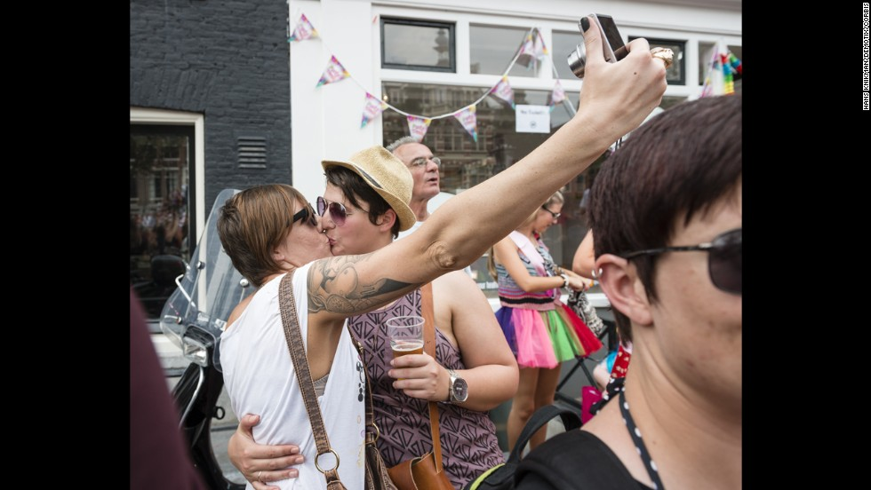"Two lesbians kiss while taking a selfie Saturday, August 2, during a gay pride parade in Amsterdam, Netherlands. <a href=""http://www.cnn.com/2014/07/30/world/gallery/look-at-me-0730/index.html"">See 16 selfies from last week</a>"