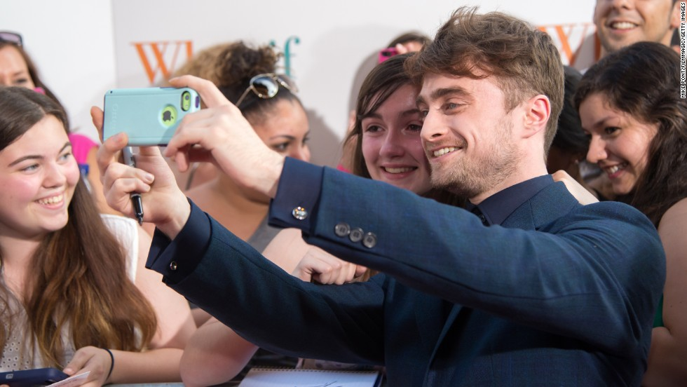 """Actor Daniel Radcliffe takes a selfie with a fan at the New York premiere of the film """"What If"""" on Monday, August 4."""