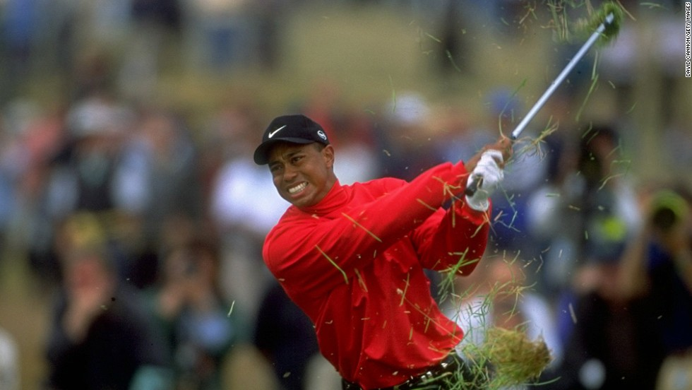 "A grimacing Tiger Woods summons all of his strength to battle his way out of the deep rough on a weather-battered Carnoustie course at the 1999 British Open.<br /><br />""Tiger has been enormously influential for all of us working in golf. It is impossible to evaluate his contribution to the game,"" says Cannon.<br /><br />""For me, apart from Seve and Greg Norman, he is my ultimate 'subject.' Every single day I go out to follow him, like Seve and Greg, he makes a picture wherever or whatever he is doing on the course at the time. <br /><br />""This moment summed up the week at Carnoustie where the rough was the fiercest I have ever seen, and Tiger found plenty of it."""