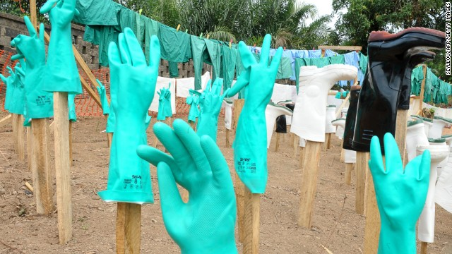 A view of gloves and boots used by medical staff, drying in the sun, at a center for victims of the Ebola virus in Guekedou, on April 1, 2014. The viral haemorrhagic fever epidemic raging in Guinea is caused by several viruses which have similar symptoms -- the deadliest and most feared of which is Ebola. AFP PHOTO / SEYLLOU (Photo credit should read SEYLLOU/AFP/Getty Images)