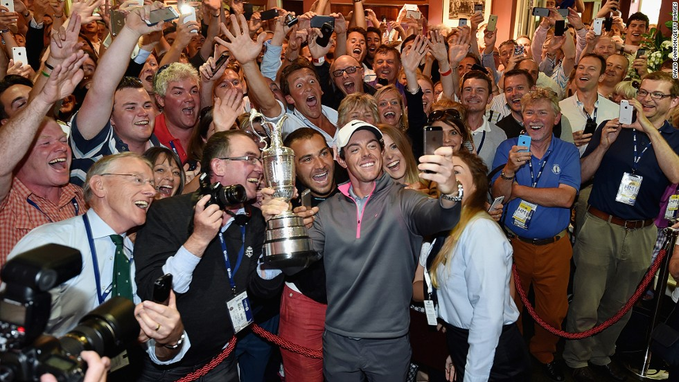"McIlroy won his third major championship at last month's British Open Championship, posing for a ""selfie"" in front of the roaring members of the Royal Liverpool Club. <br /><br />""As a member of the club myself, this picture means so much to me in more ways than one,"" Cannon says. <br /><br />""I have been lucky enough to have known Rory since he was 15 years old and have seen his incredible talent develop into one of the game's great players. Who knows what lies ahead for him? <br /><br />""All I know is that this moment is one I will treasure forever."""
