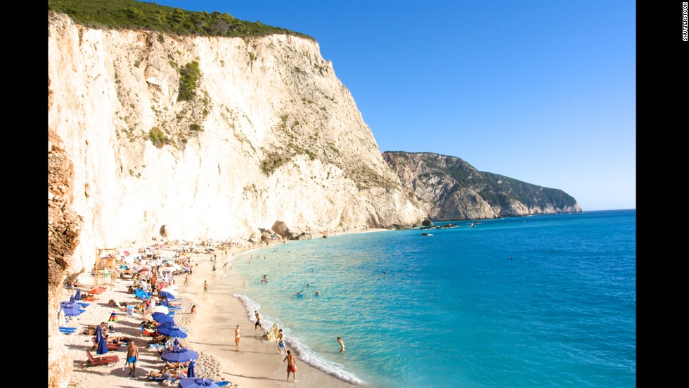 Porto Katsiki's stunning setting draws crowds. Located on the Ionian Island of Lefkada, it's best to arrive early or late or visit during the off-season for a bigger slice of sand and a smoother arrival. The narrow road to the beach and the parking area above can get very tight. Many sunbathers arrive by boat.