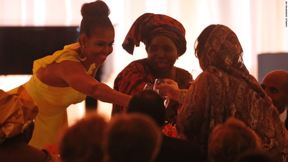 First lady Michelle Obama offers a toast to guests after President Barack Obama offered a toast.
