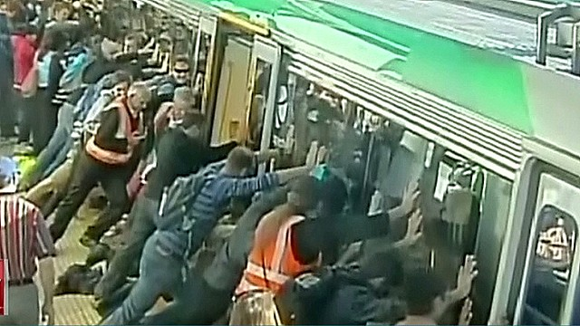 Passengers push to free man's trapped leg