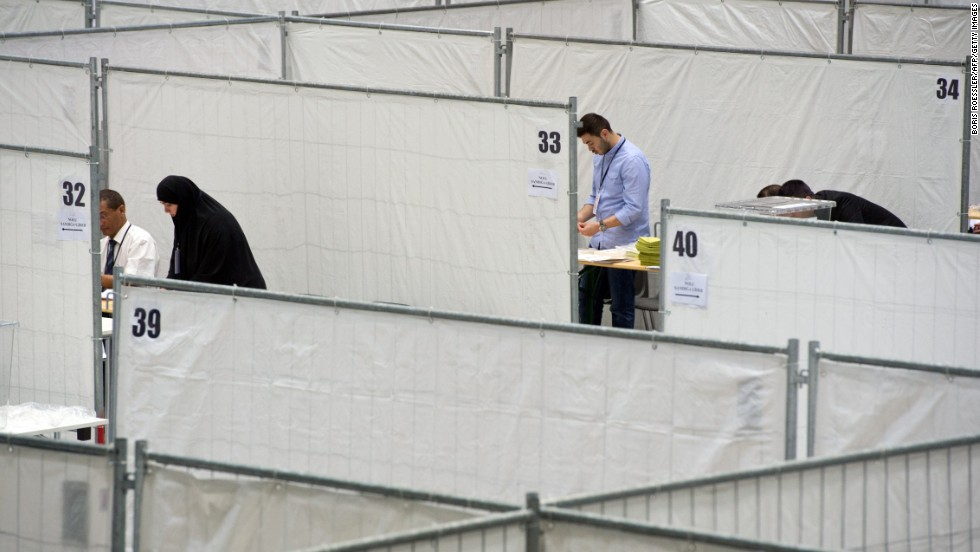 Election workers prepare polling booths Thursday, July 31, in Frankfurt, Germany, where members of Germany's Turkish community would cast their votes.