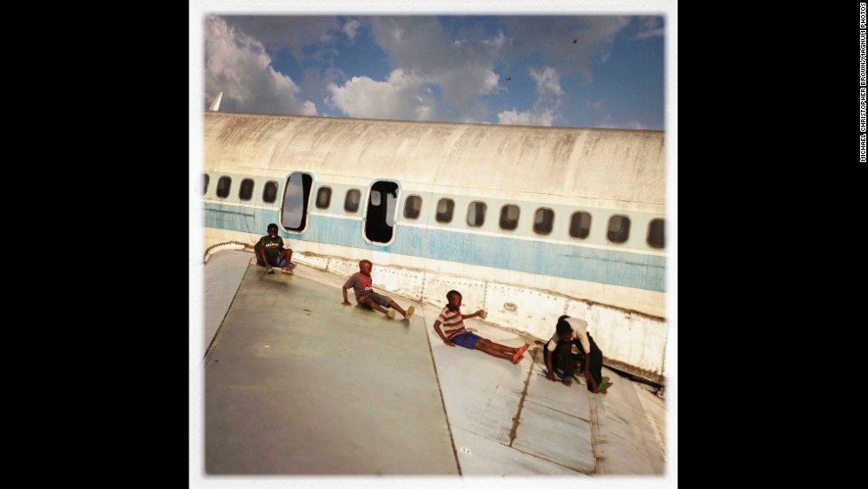 Children have turned the disused Goma Airport in the Democratic Republic of Congo into a makeshift playground.