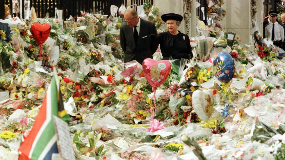 While at Buckingham Palace, Queen Elizabeth II and Prince Philip view the floral tributes to Princess Diana after her tragic death in 1997.