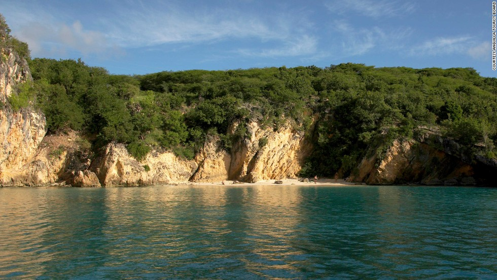 There are two ways to get to Anguilla's Little Bay Beach: by boat or by cliff. There's a rope that runs the length of the cliff to help climbers down or you can navigate on your own using the natural grips of the rock. Tread carefully.