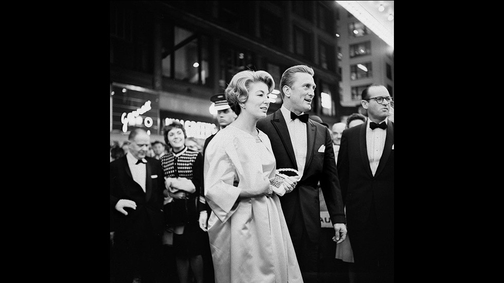 """A number of Maier's photographs feature some of the most celebrated personalities of her era, such as Audrey Hepburn, Frank Sinatra, and in this picture, Kirk Douglas.<br /> <br />""""She was a film buff, she knew a lot about foreign films and where all the premieres were taking place,"""" says John Maloof. """"She would also go to book signings and take photos of the authors."""""""