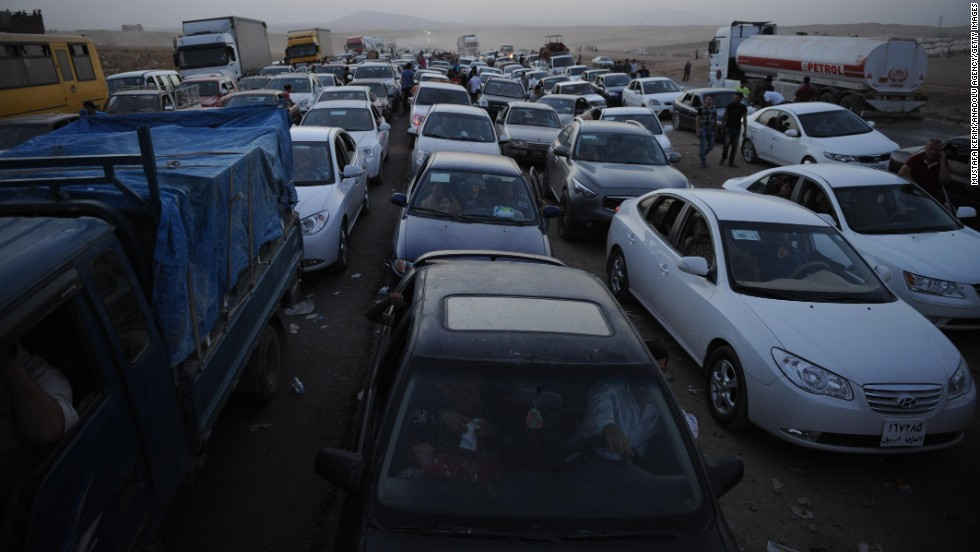 Thousands of Yazidi and Christian people flee Mosul on Wednesday, August 6, after the latest wave of ISIS advances.