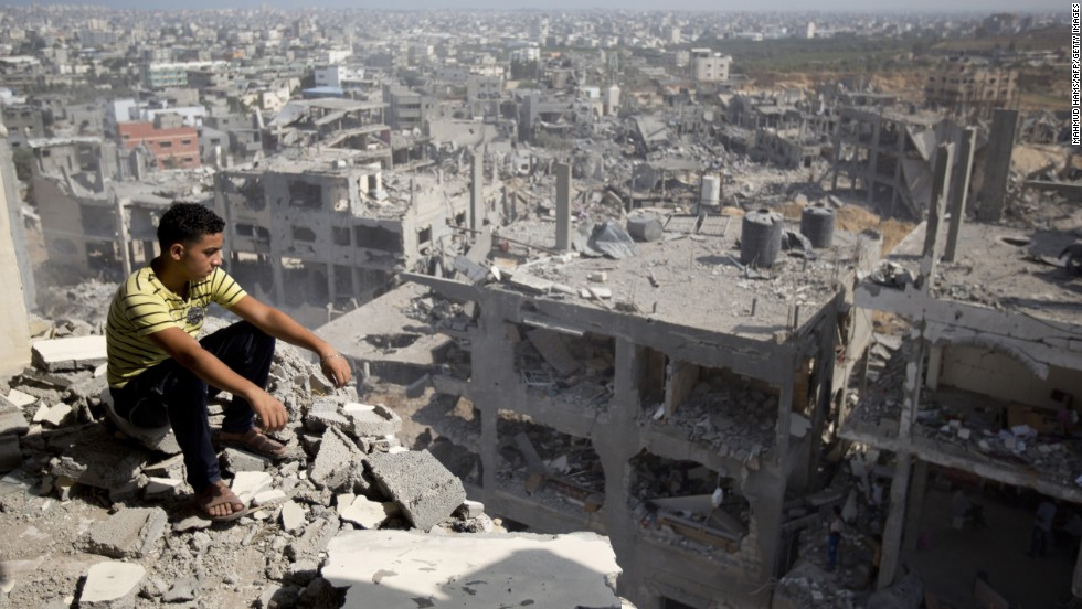A Palestinian man looks out over destruction in the al-Tufah neighborhood of Gaza City on Wednesday, August 6.