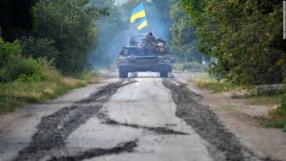 Ukrainian troops patrol near the village of Novoselovka on Thursday, July 31.