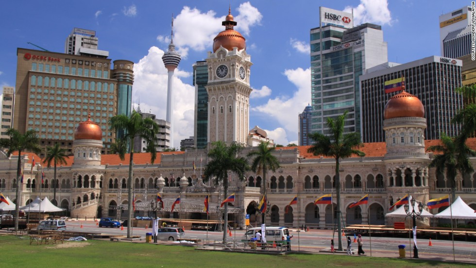<strong>Sultan Abdul Samad Building's Clock Tower, Kuala Lumpur, Malaysia</strong><br /><strong>Completed: </strong>1897<br /><strong>Height: </strong>40 meters (131 feet)<strong><br />Architect: </strong>A.C. Norman<br /><strong>Special feature</strong><br />Topped with a golden dome, the building is a blend of Moorish and British design.<em><br />More on the next slide.</em>