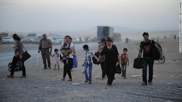 ERBIL, IRAQ - AUGUST 6:  Thousands of Yazidi and Christian people flee Hamdaniyah town of Mosul to Erbil after the latest wave of ISIL advances that began on Sunday has seen a number of towns near Iraq's second largest city Mosul fall to the militants on August 6, 2014. (Photo by )