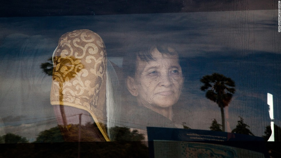 "A Cambodian who survived <a href=""http://www.cnn.com/2014/08/06/world/asia/cambodia-khmer-rouge-timeline/index.html"">the Khmer Rouge's brutal rule</a> looks through a bus window on Thursday, August 7, after guilty verdicts were handed down to two of the regime's former leaders in Phnom Penh, Cambodia. Nuon Chea, otherwise known as Brother Number Two, and Khieu Samphan, the one-time President of Democratic Kampuchea, were sentenced to life in prison after being convicted of crimes against humanity. At least 1.7 million people -- nearly a quarter of Cambodia's population -- were killed by execution, disease, starvation and overwork under the Khmer Rouge's rule from 1975 to 1979."