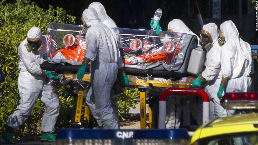 "Paramedics wear protective suits as they move Miguel Pajares, a missionary infected with Ebola, to a hospital in Madrid for treatment on Thursday, August 7. Pajares contracted the disease in Liberia. Health officials say the current <a href=""http://www.cnn.com/2014/04/04/world/gallery/ebola-in-west-africa/index.html"">Ebola outbreak in West Africa</a> is the deadliest ever."