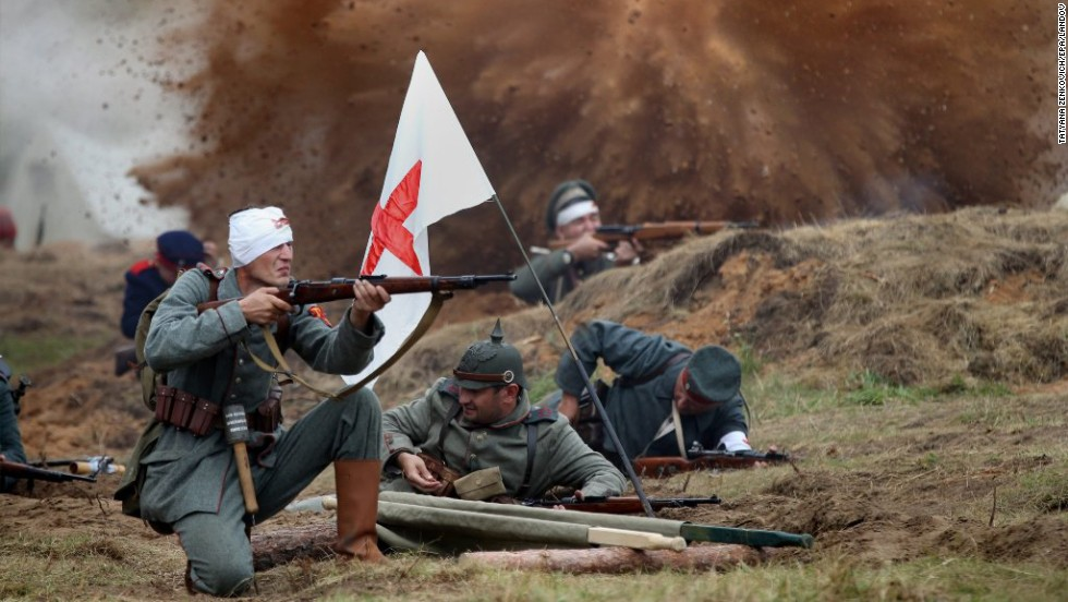People dressed as German soldiers take part in a World War I re-enactment near the town of Smorgon, Belarus, on Friday, August 1.