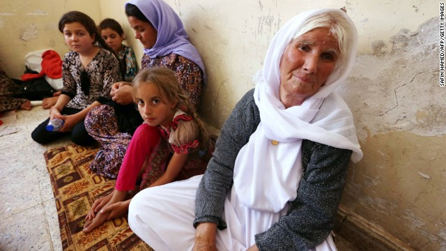 Fleeing Yazidi families take shelter at a school in Dohuk in Iraq's Kuristan region.