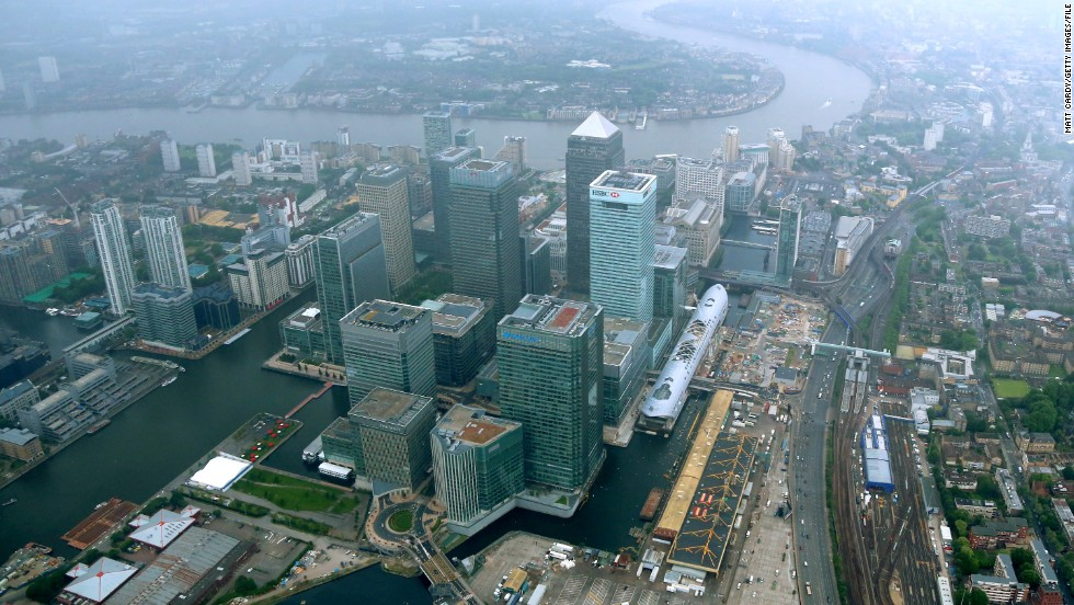 "In the late 1980s the site was redeveloped, including financial sector Canary Wharf (pictured). ""When the Docklands first opened, they were a closed working space,"" said Georgina Young, senior curator at the Museum of London. ""So this also represents an opening up of the area, with more of a focus on wealth and luxury."""