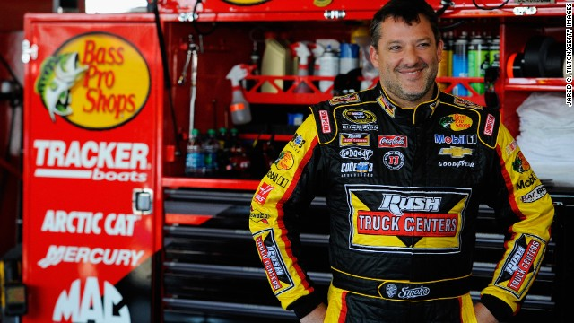 Tony Stewart, driver of the #14 Rush Truck Centers/Mobil 1 Chevrolet, looks on in the garage area during practice for the NASCAR Sprint Cup Series Cheez-It 355 at Watkins Glen International on August 8, 2014 in Watkins Glen, New York. (Photo by Jared C. Tilton/Getty Images)