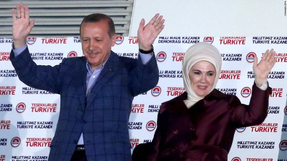 Turkish President-elect Recep Tayyip Erdogan and his wife, Emnine, cheer their supporters after the results of elections at the headquarters of Turkey's ruling Justice and Development Party (AKP) in Ankara on Sunday, August 10. Erdogan will become the country's first directly elected president by a wide margin of votes, according the semi-official Anadolu News Agency.