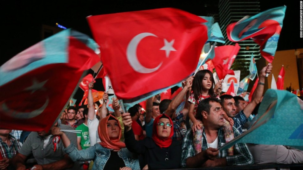 Erdogan supporters celebrate his victory in front of the AKP party headquarters in Ankara on August 10.