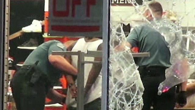 Fatal shooting sparks looting, violence