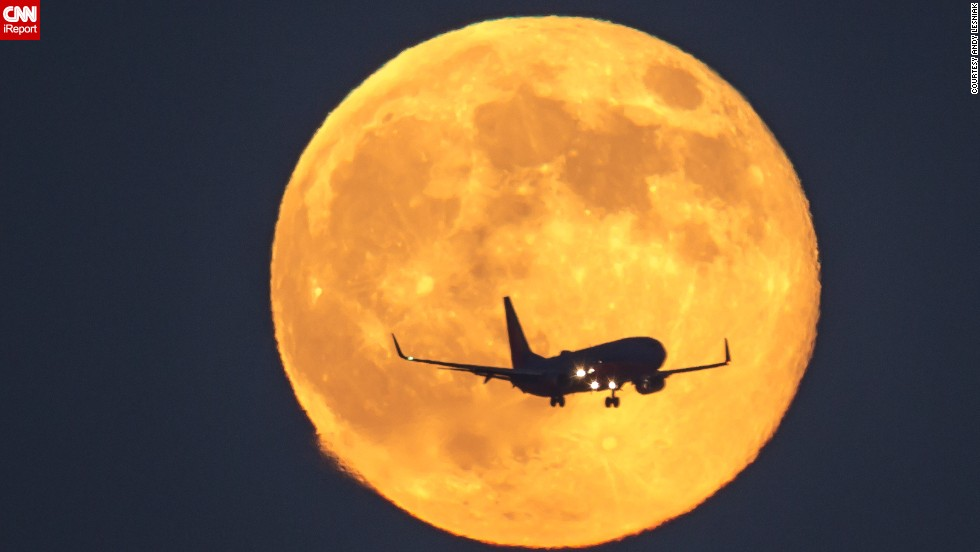 """Where we live, the moon always rises close to the approach path of landing planes, yet it's rare for it to cross the path perfectly,"" says Los Angeles resident <a href=""http://ireport.cnn.com/docs/DOC-1160208"">Andy Lesniak</a>, who snapped this image on Sunday."
