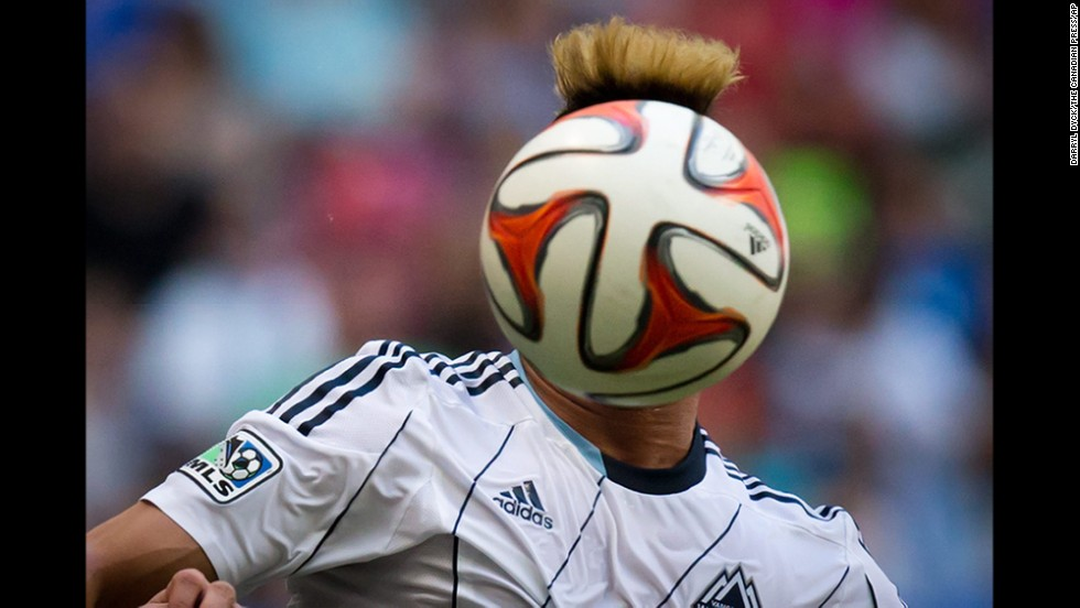 The face of Vancouver Whitecaps player Erik Hurtado is hidden by the ball in this photo taken during a Major League Soccer game Sunday, August 10, in Vancouver, British Columbia.