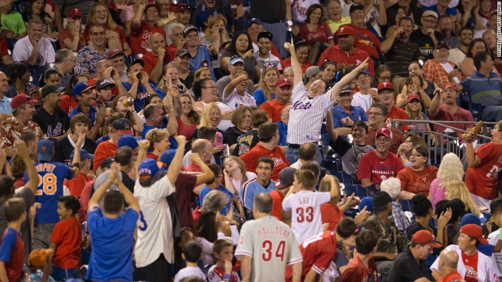 A New York Mets fan celebrates after catching a foul ball Friday, August 8, during a Mets-Phillies game in Philadelphia.